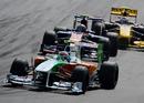 Tonio Liuzzi leads Jaime Alguersuari and Vitaly Petrov