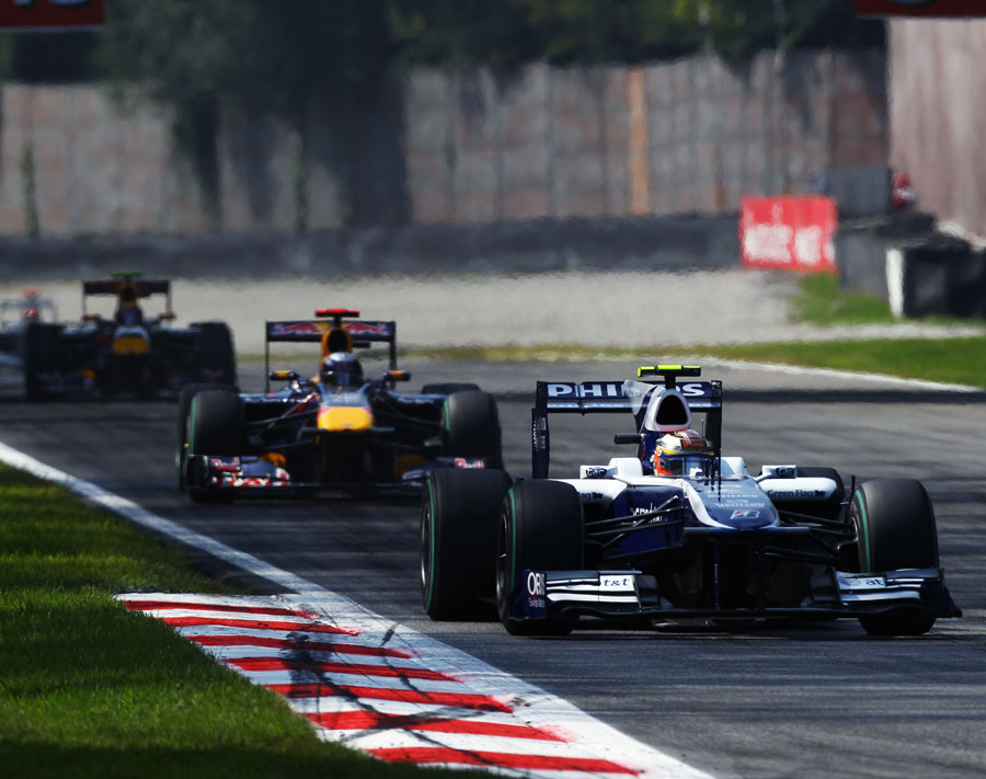 Nico Hulkenberg leads the Red Bulls of Sebastian Vettel and Mark Webber