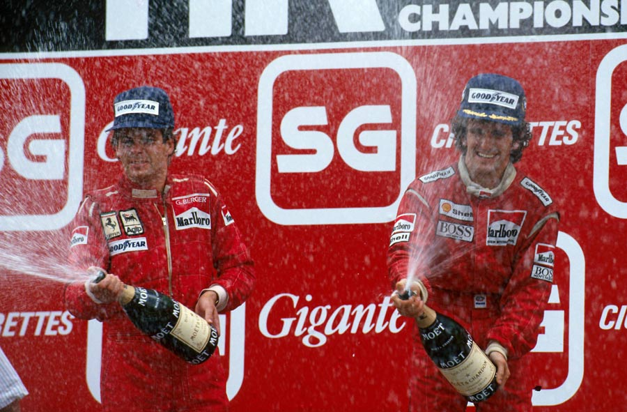 Alain Prost celebrates a win, with Gerhard Berger finishing second