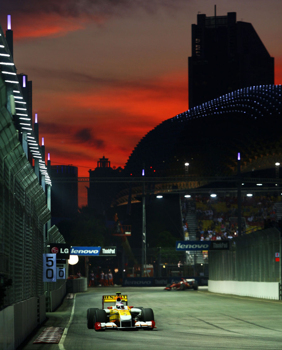 Romain Grosjean drives his Renault during sunset