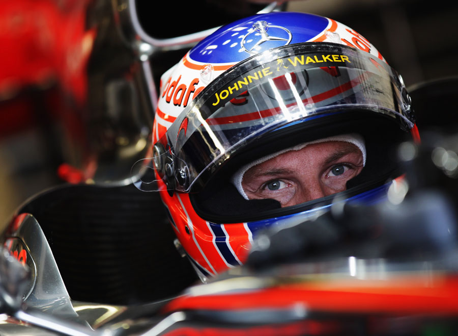 Jenson Button prepares to leave the McLaren garage