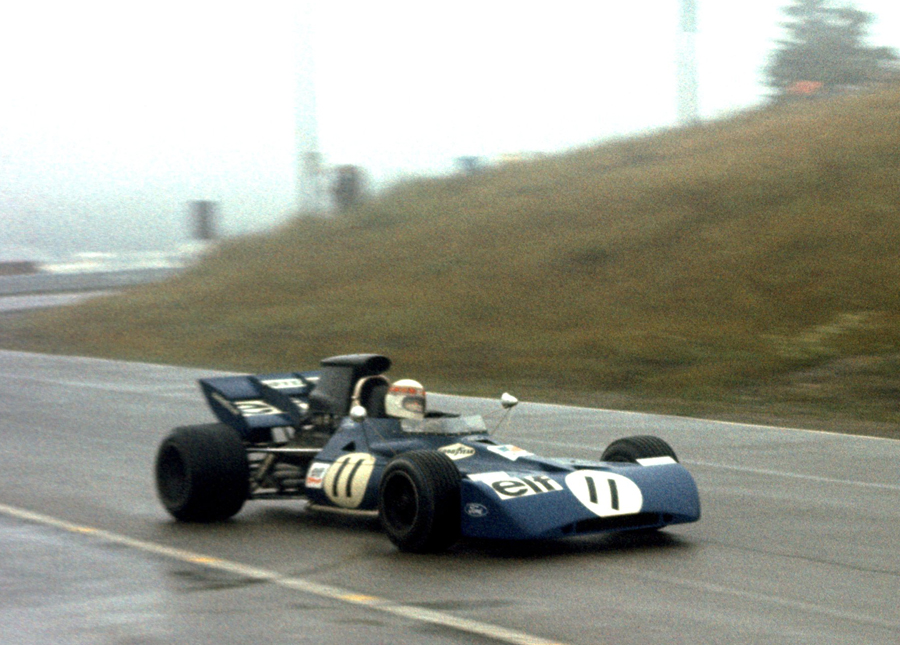 Jackie Stewart speeds through the mist and rain to win