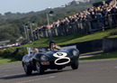 Sir Stirling Moss demonstrates a Jaguar D-Type