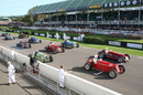Pre-war grand prix cars line up on the grid