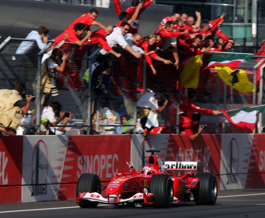 Rubens Barrichello takes the plaudits from the pit wall after winning the debut Chinese Grand Prix
