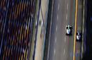 Adrian Sutil and Michael Schumacher go wheel-to-wheel