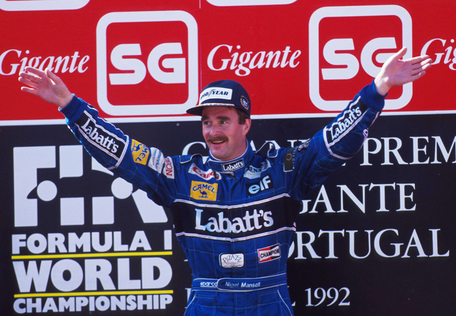 Nigel Mansell celebrates his record-breaking ninth win of the season