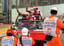 Fernando Alonso and Felipe Massa acknowledge the crowd on the parade lap