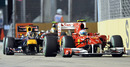 Fernando Alonso leads Sebastian Vettel away at the start