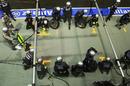 The Mercedes pit crew prepare for Michael Schumacher