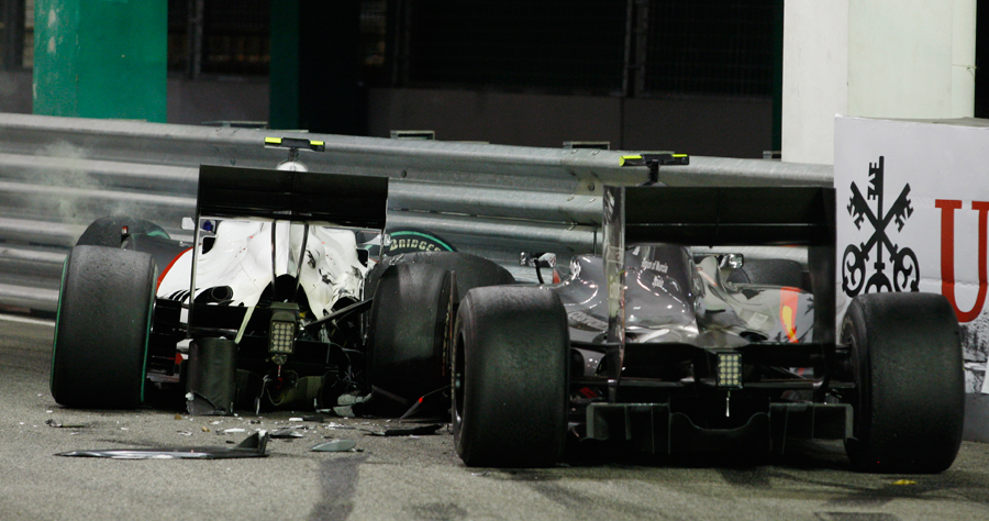 Debris surrounds the abandoned cars of Kamui Kobayashi and Bruno Senna