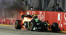 Heikki Kovalainen's Lotus blazes as he slowly brings it to a halt
