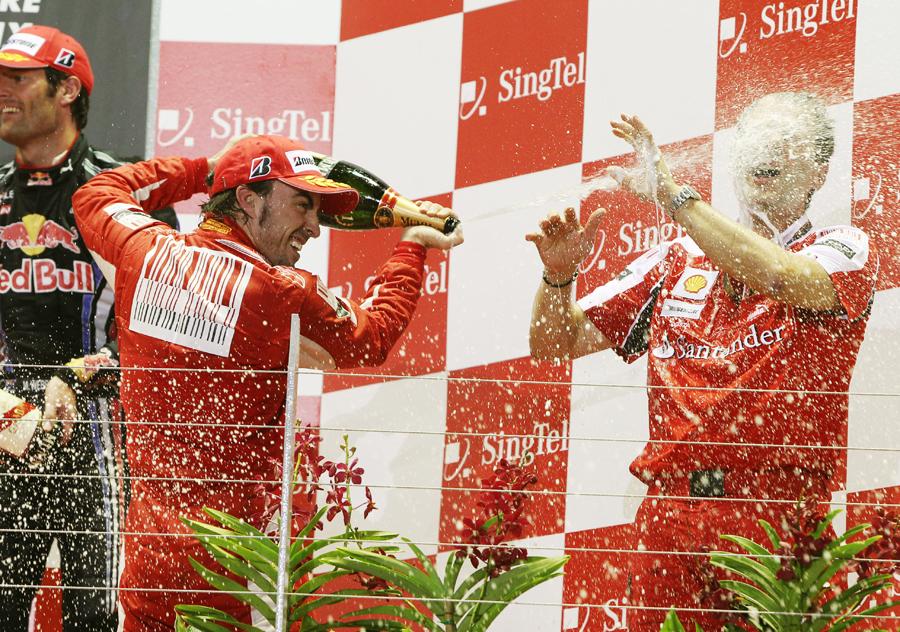 Fernando Alonso soaks Ferrari's technical director Aldo Costa