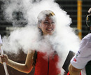 A Lotus engineer keeps a grid girl cool