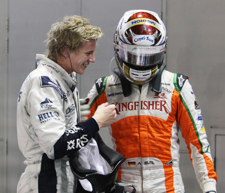 Nico Hulkenberg and Adrian Sutil share a joke after the race