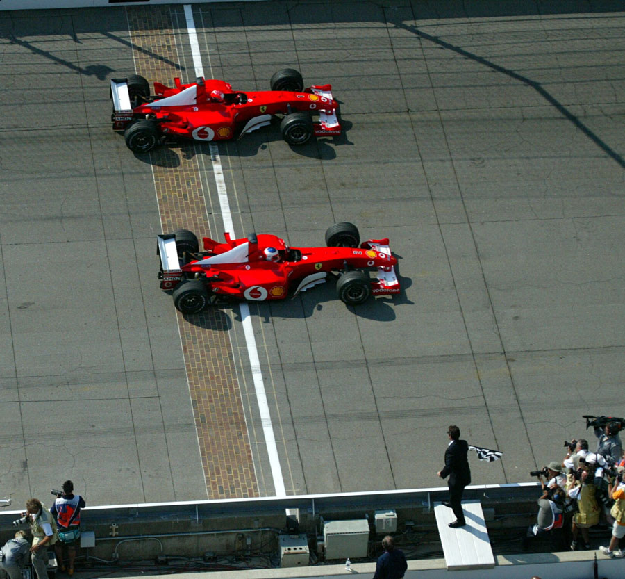 Rubens Barrichello beats Michael Schumacher across the line by 0.011 seconds in a staged finish