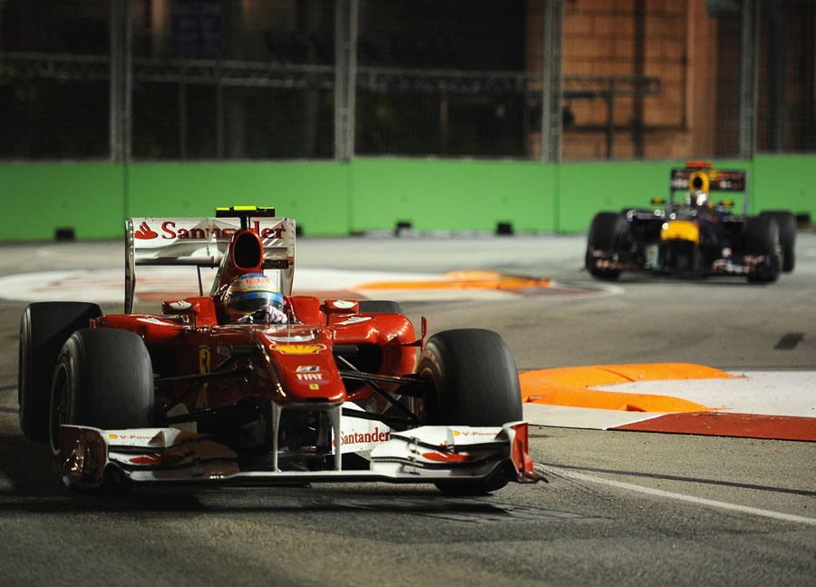 Fernando Alonso leads Sebastian Vettel through the turn 10 chicane