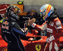 Sebastian Vettel and Fernando Alonso shake hands after the race
