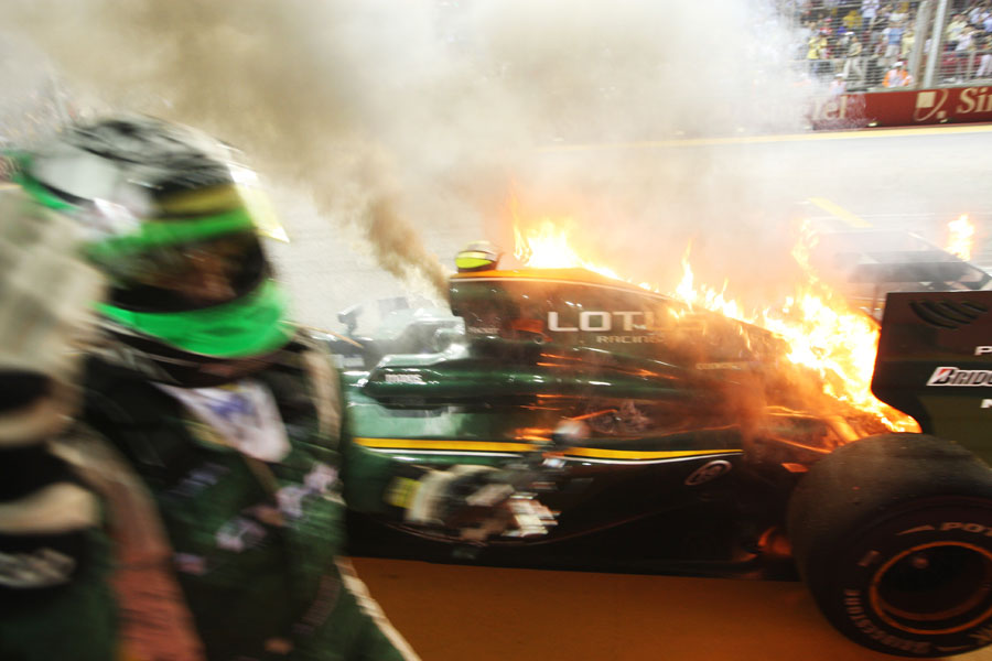 In the heat of the moment: Heikki Kovalainen looks for a fire extinguisher