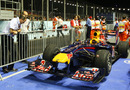 McLaren engineers Jonathan Neale and Phil Prew take a look at the Red Bull in Parc Ferme