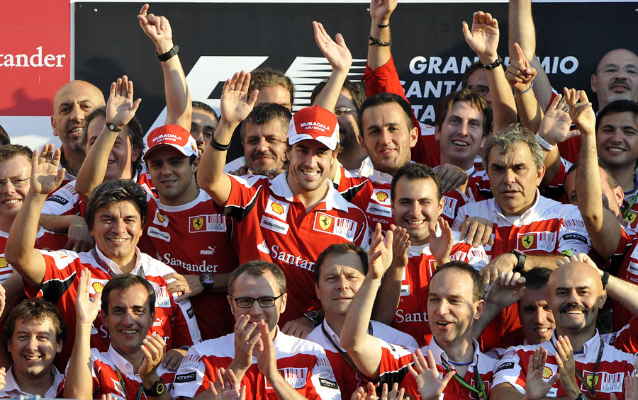 Fernando Alonso celebrates with the Ferrari team
