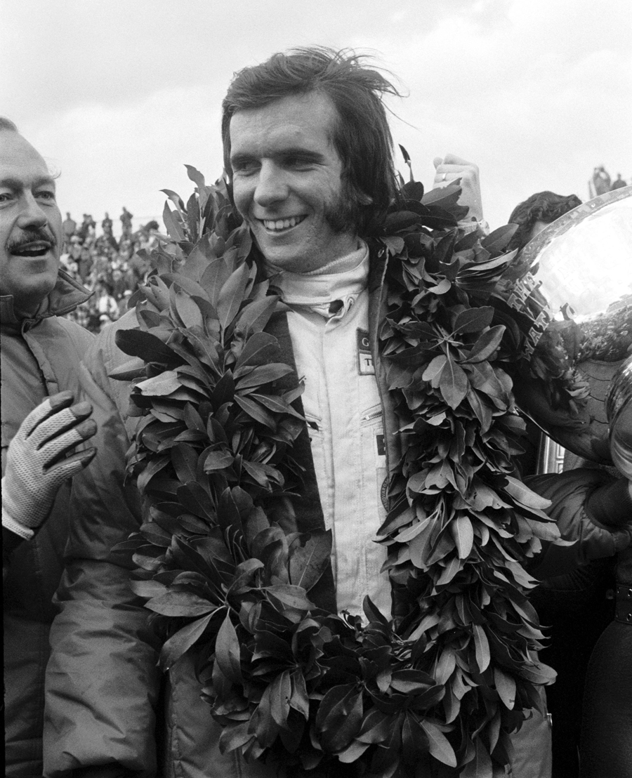 Emerson Fittipaldi celebrates victory at the 1970 US Grand Prix