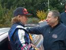 Kimi Raikkonen and Jean Todt are deep in conversation
