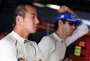 Sakon Yamamoto and Bruno Senna in the HRT garage