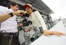 Sakon Yamamoto talks to his engineer on the pit wall
