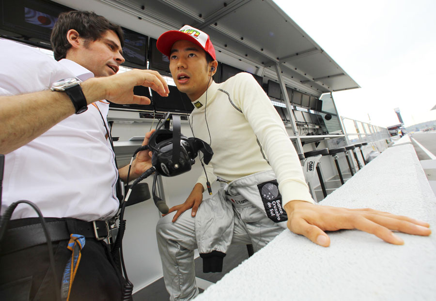 Sakon Yamamoto talks to his engineer on the pit wall