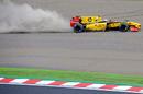 Vitaly Petrov runs wide over the gravel