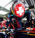 Sebastien Buemi clambers into his Toro Rosso