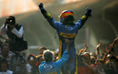 Fernando Alonso celebrates a season-ending win in China