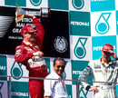 Eddie Irvine celebrates his win in Malaysia, shortly before being disqualified