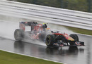 Jaime Alguersuari braves the soaking wet conditions