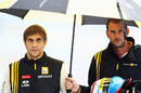 Vitaly Petrov takes shelter from the pouring rain