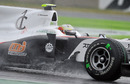 Kamui Kobayashi ploughs through the water