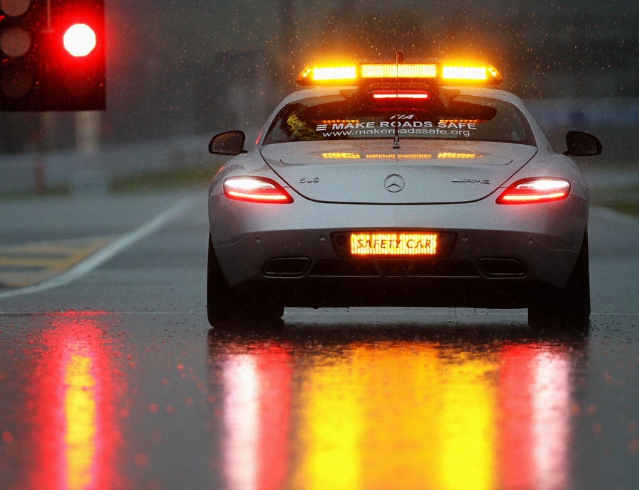 The FIA safety car takes to the circuit to evaluate track conditions in fading light
