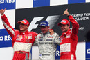McLaren's Kimi Raikkonen is flanked by Michael Schumacher and Rubens Barrichello