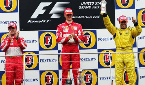 Michael Schumacher celebrates after winning the 2005 United States Grand Prix