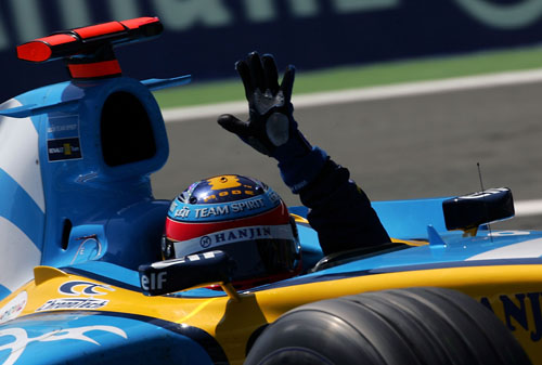 Fernando Alonso celebrates after winning the 2005 French Grand Prix