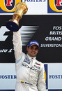 McLaren's Juan-Pablo Montoya celebrates after winning the 2005 British Grand Prix