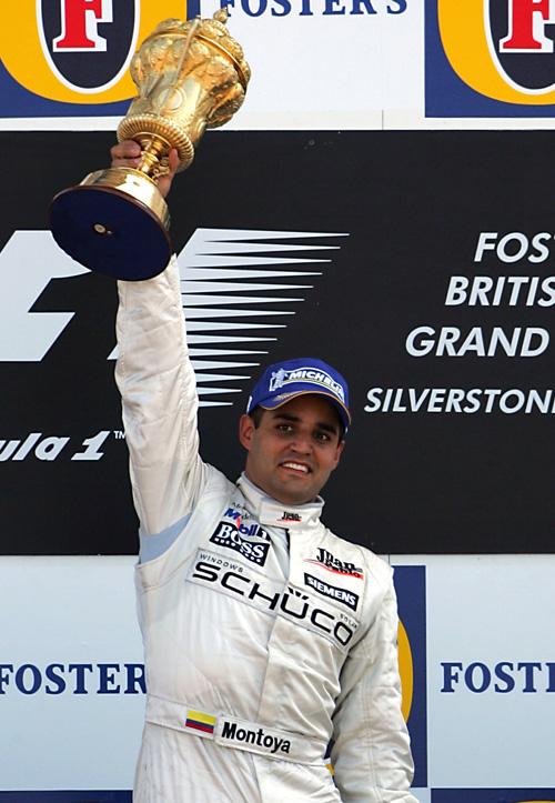 McLaren's Juan-Pablo Montoya celebrates after winning the 2005 British Grand Prix