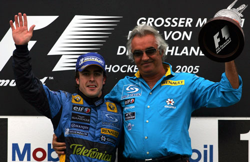 Fernando Alonso celebrates with Renault boss Flavio Briatore after winning the 2005 German Grand Prix
