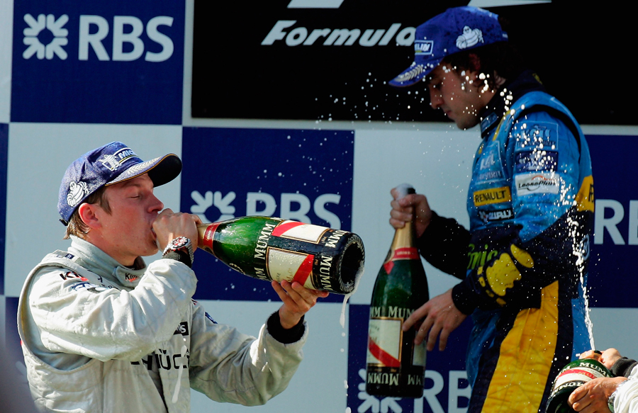 Kimi Raikkonen celebrates on the podium after winning the 2005 Turkish Grand Prix