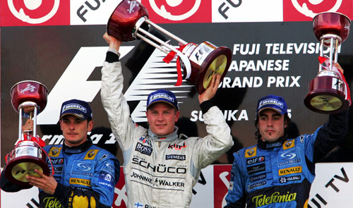 Kimi Raikkonen, Giancarlo Fisichella, Fernando Alonso on the podium at the 2005 Japanese Grand Prix