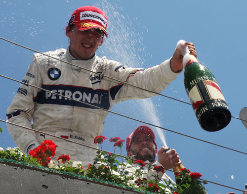 Robert Kubica celebrated his maiden victory
