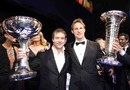 Two world champions, Jenson Button and WRC champion Sebastien Loeb with their trophies
