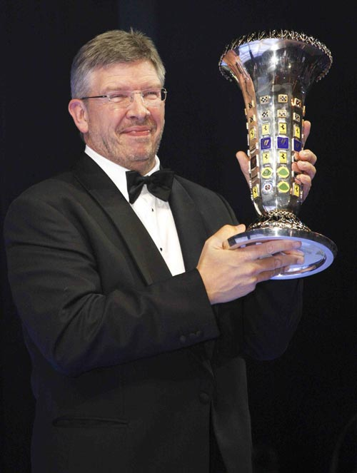 Ross Brawn collects the championship trophy on behalf of Brawn GP