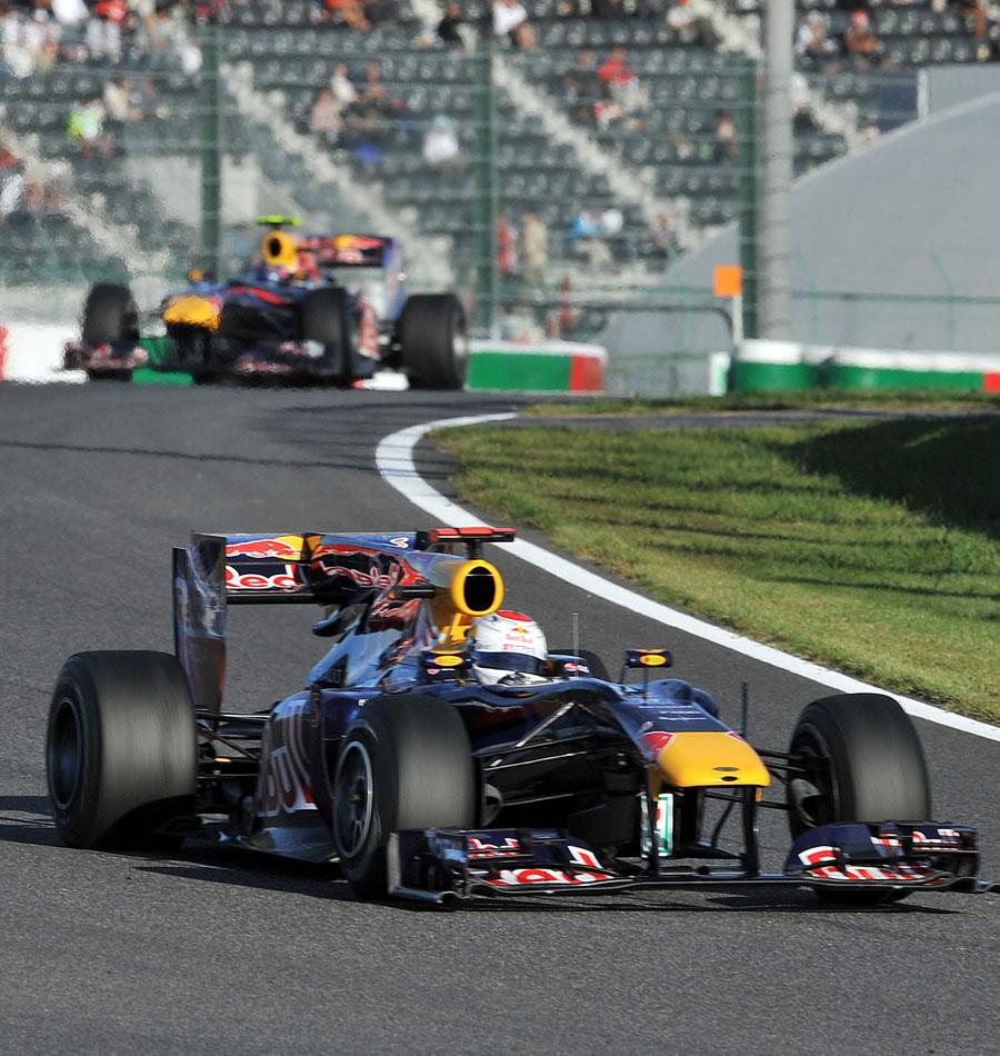 Sebastian Vettel leads Mark Webber home